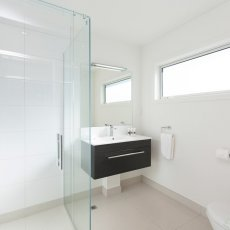 Bathroom looking toward the vanity at The Dawson Motel New Plymouth. Call 06 758 1177